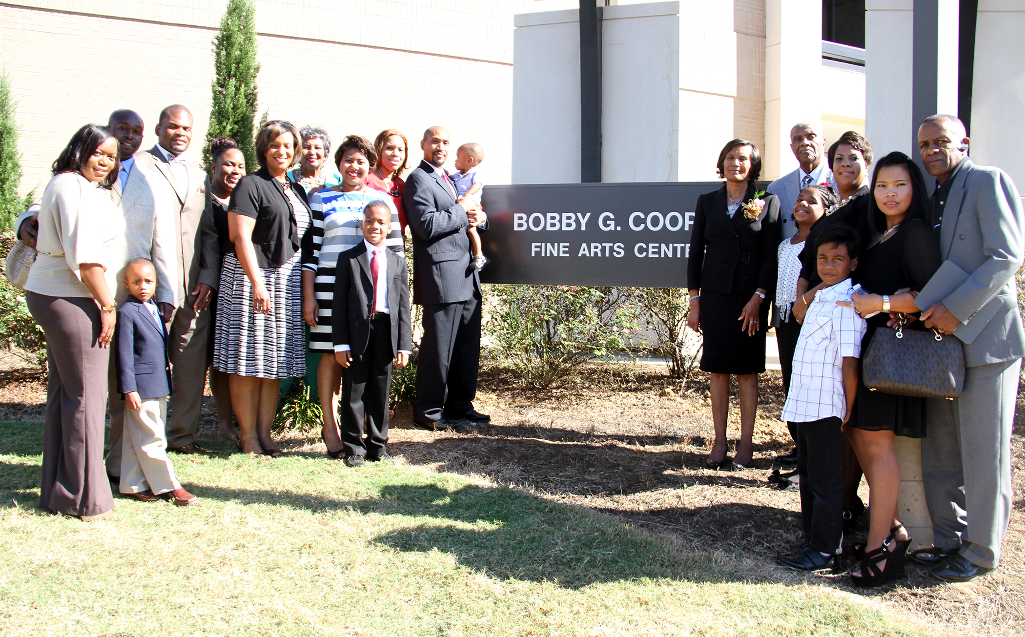 Family members of Dr. Bobby Cooper gather for the ribbon-cutting for the building on the Utica Campus. Photo courtesy Hinds Community College