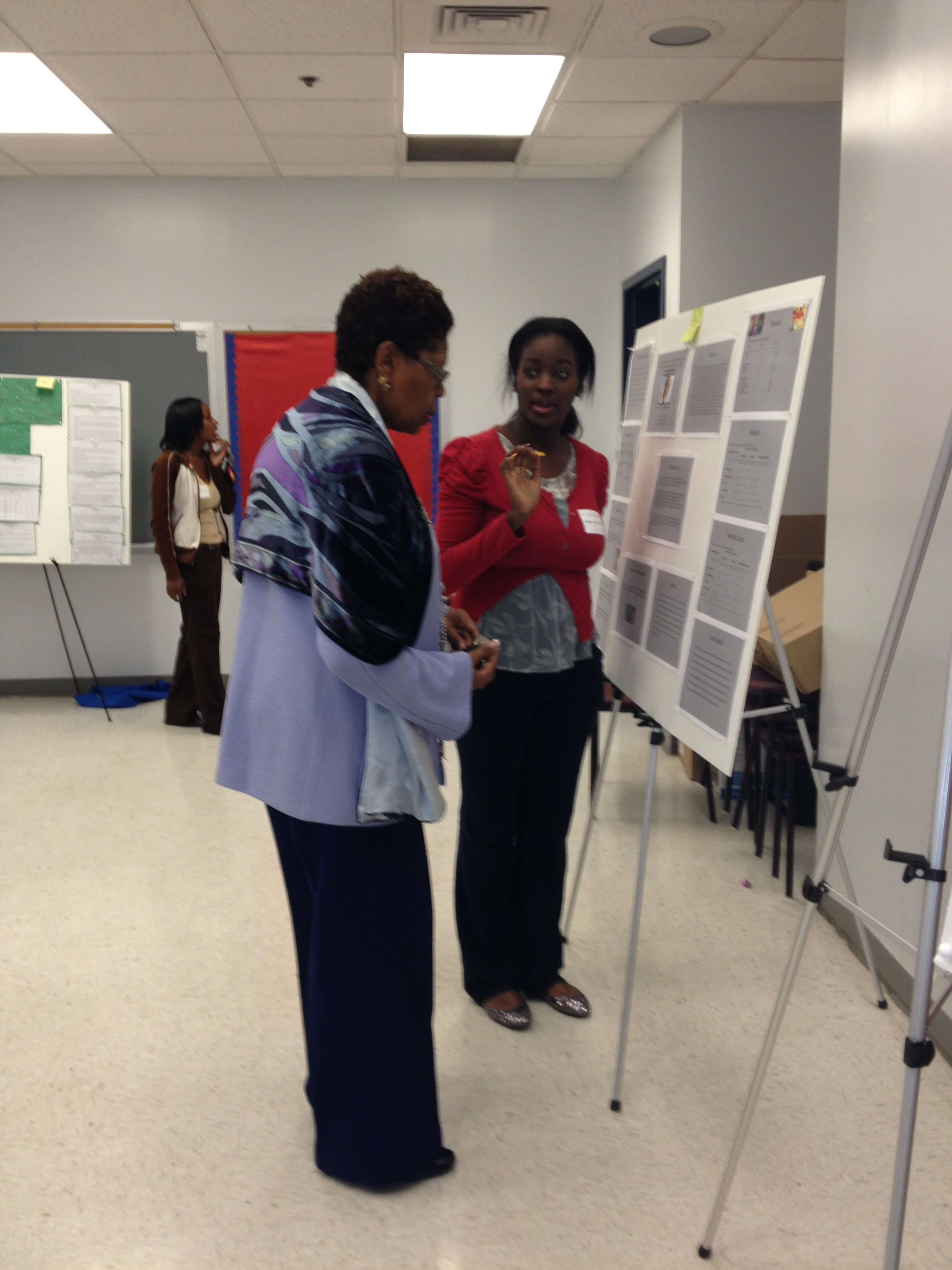 Provost attending to a student poster presentation