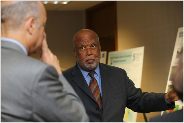 Congressman Bennie G. Thompson uses poster to discuss our research with Secretary of Homeland Security Mr. Jeh Johnson.